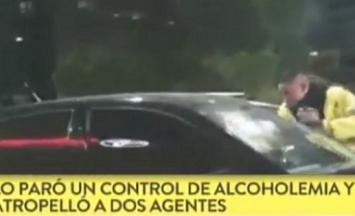 Quiso evitar un control de alcoholemia y se llevó en el capot a un agente de tránsito